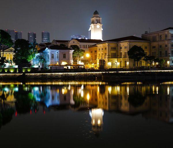 Victoria theatre by river at night