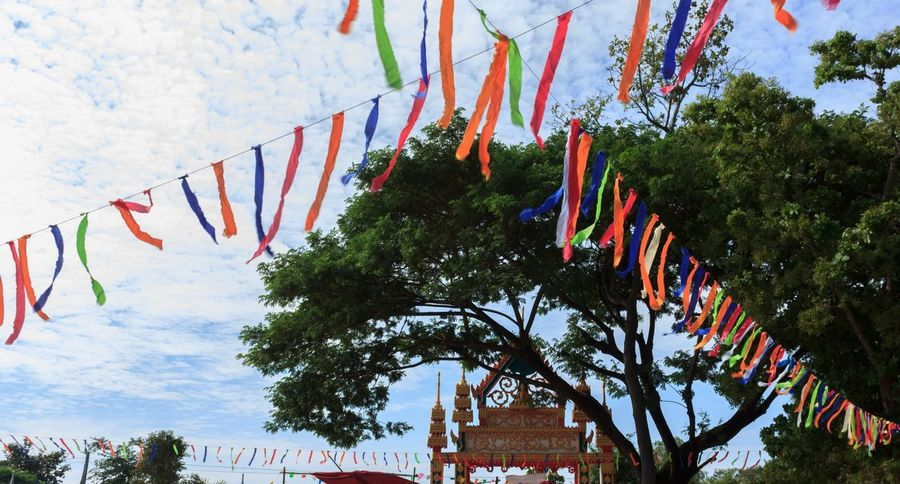 Culture Cultures Day Decoration Decorations Decorative Low Angle View No People Outdoors Religion Religion And Beliefs Religions Religious  Religious Art Ribbon Ribbon (: Ribbon And Bows Ribbons Sky Thai Thailand Tradition Traditional Traditional Culture Traditions