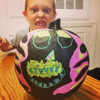 "Francis' ""Ghost Rider"" Pumpkin...front side! He looks just like his pumpkin. Heehee..."