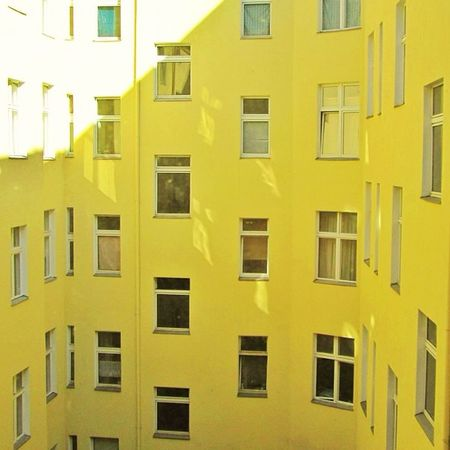 Yellow internal courtyard Perspective Ventana Architecture Lookingup Abstract Vanishingpoint Berlin Architectureporn Urban Archidaily Windows Archilovers Façade Insta_germany Germany Pared Wall Lines Window LINE Yellow Ventanas ArchiTexture