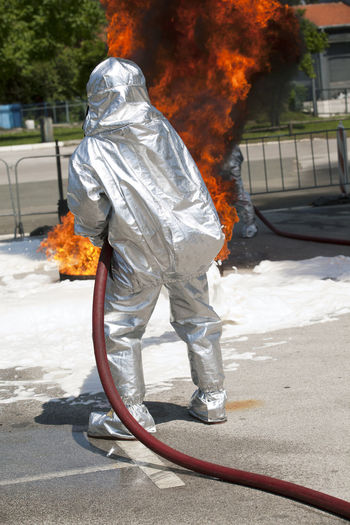 Firefighter in action Fireman Rescue Actions FireFighting  Firefighter Flames Public Service Announcement Service Spraying Danger Drill Emergency Services Fire Fire Department In Action Fire Hose Fire Protection Fire Protection Suit Foam Art Heat Protective Workwear Public Safety Training Urgency