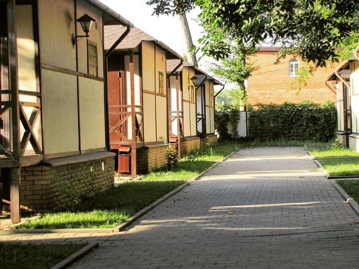 Narrow paved footpath between houses