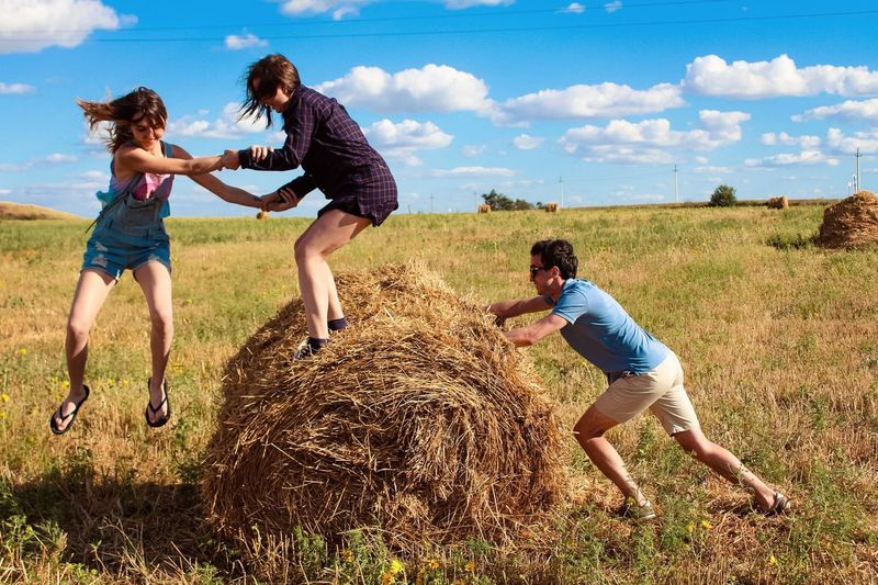 Enjoy The New Normal Fun Jumping Sumner Hay Stack Of Hay Friends Joy Amusement  Lark Clouds Sky Outdoor Recreation EyeEm Selects Done That.