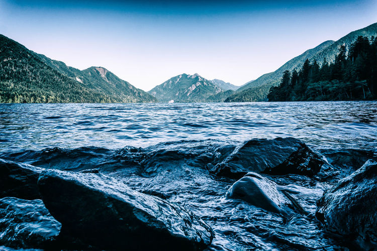 Lake Crescent Beauty In Nature Clear Sky Cold Temperature Day Environment Flowing Water Idyllic Mountain Mountain Range Nature No People Non-urban Scene Outdoors Remote Rock Scenics - Nature Sky Tranquil Scene Tranquility Water Winter