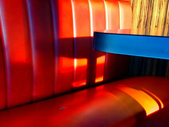Red Backgrounds Multi Colored Abstract Pattern No People Indoors  Day Seating Bench Seat Table Table Light & Shadow Light & Color Light & Shadow 📷 Light & Object Leather Seat Wooden Texture Ripped Seats Sunlight Sun Dining Room Dining Table Dining Out Dining In Nice Ambience