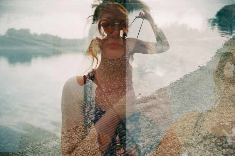 Multiple Exposure Of Young Woman And Lake