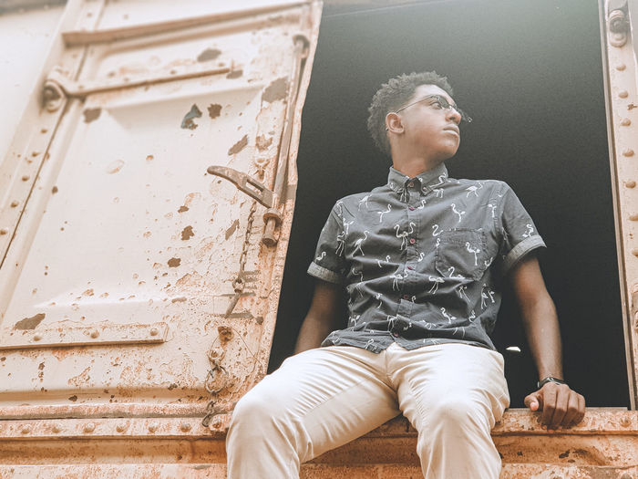 Low angle view of young man looking away