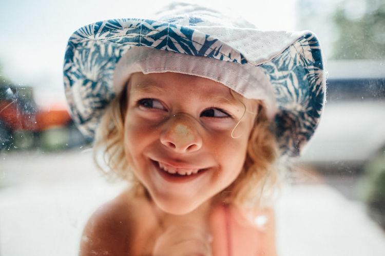 Portrait of smiling girl wearing hat