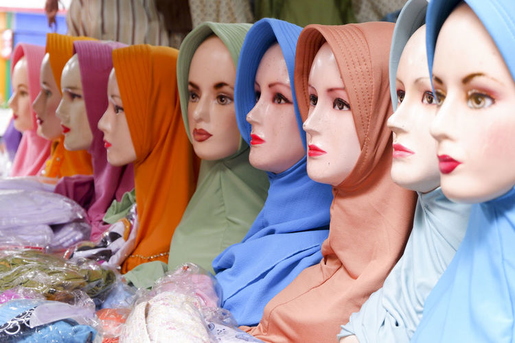 Close-up of mannequins wearing colorful hijabs