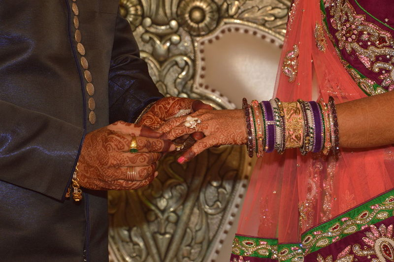 Couple Holding Hands On Indian Wedding