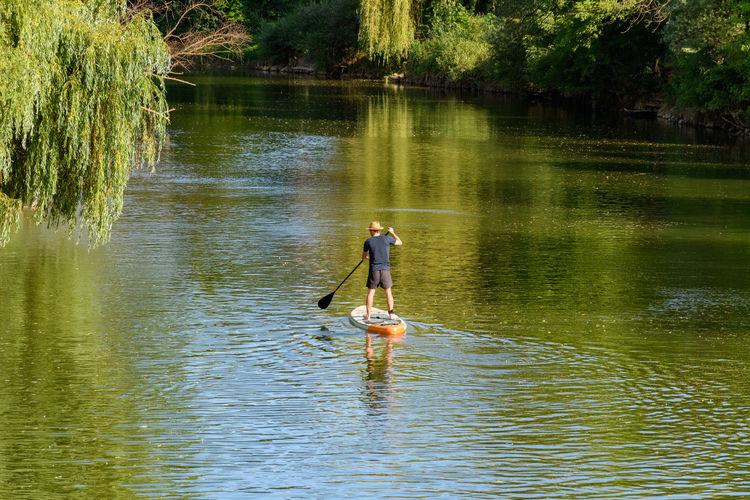 Man surfing in lake