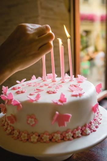 Close-up of hand holding ice cream cake