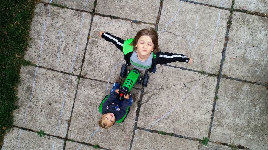 A New Beginning City Portrait Smiling Shadow Happiness Looking At Camera Childhood Playing High Angle View Full Length Paved