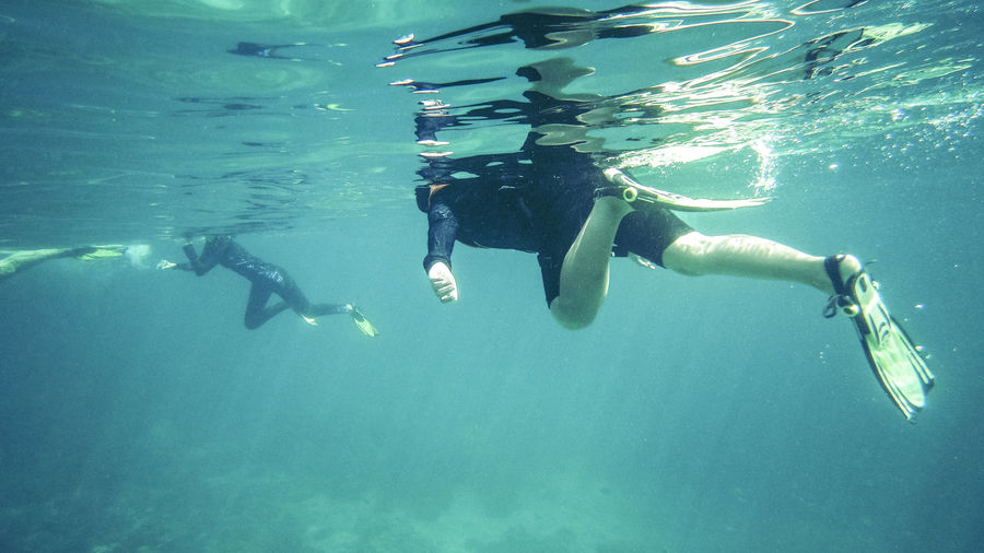 Underwater Sea Swimming Water UnderSea Sport Adventure Leisure Activity Aquatic Sport Exploration Lifestyles Nature Real People People Diving Equipment Scuba Diving Snorkeling Diving Flipper Outdoors Underwater Diving Human Arm Turquoise Colored