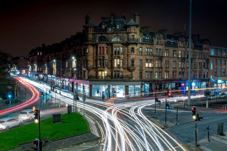 Standing still amidst the chaos Urban Glasgow  Architecture Illuminated Building Exterior Built Structure Night Transportation City Road Light Trail Street Long Exposure Motion Building City Life High Angle View