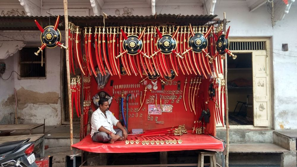 small traditional shop of rajputana arms Architecture Built Structure Day Men Occupation Outdoors Real People Sitting Small Business Archway Residential Structure
