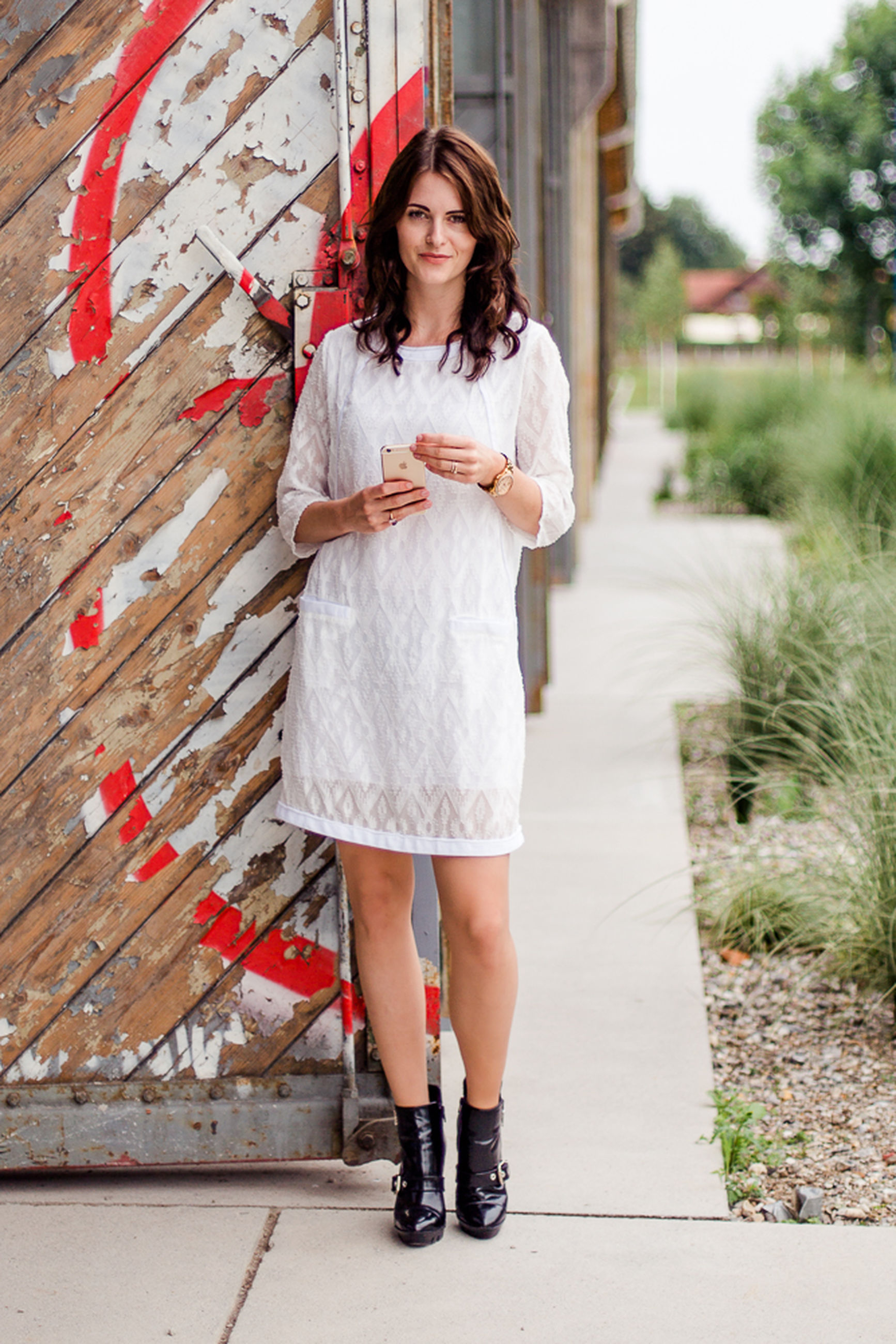 young adult, casual clothing, person, young women, full length, portrait, looking at camera, front view, lifestyles, standing, leisure activity, smiling, fashion, long hair, dress, outdoors, built structure