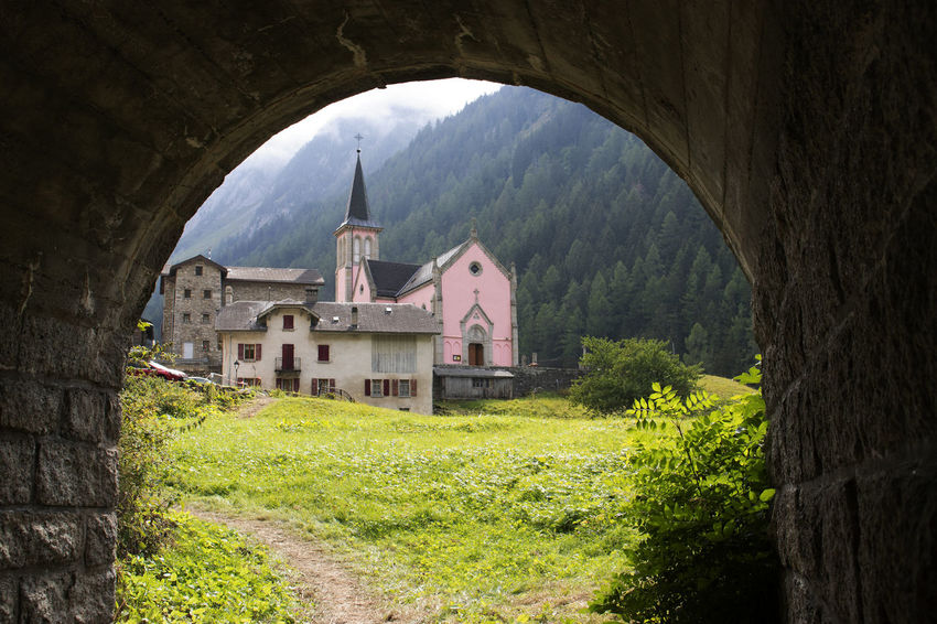 The pink church near Trient Switzerland Trient Arch Architecture Building Building Exterior Built Structure History Outdoors Pink Church Place Of Worship Religion Switzerland