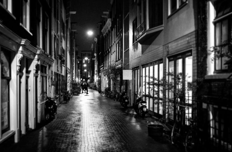 Architecture Building Exterior Built Structure City The Way Forward Building Direction Street Illuminated Night Incidental People Real People Residential District Walking Lifestyles Outdoors Lighting Equipment Diminishing Perspective Alley Footpath