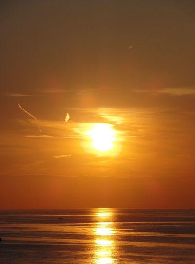 Sunset Reflection Sea Beauty In Nature Scenics Nature Sun Water Horizon Over Water Tranquil Scene Beach Sky Sunlight Tranquility EyeEmNewHere The Week On EyeEm Enjoying The View Holiday Enjoying Life