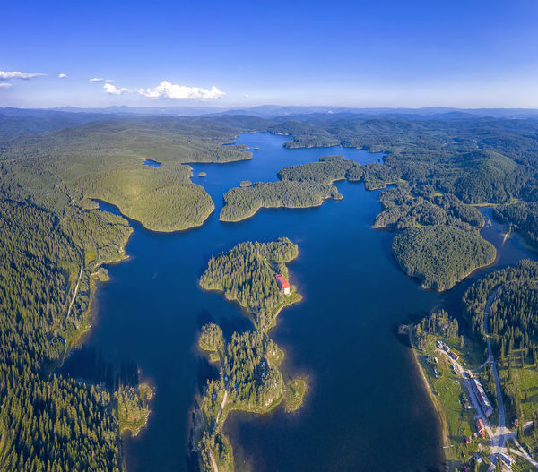 Aerial view of lake against blue sky