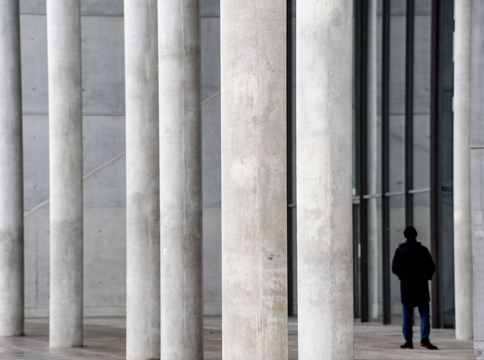 Rear view of a man walking in building