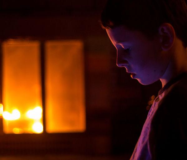 Close-Up Of Young Boy At Night