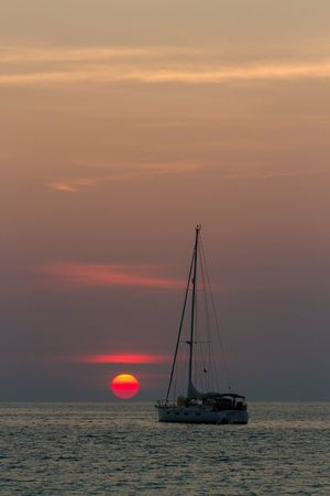Sailboat silhouette on beautiful tropical sunset background Tropical Andaman Sea Ocean Phuket,Thailand Phuket Nai Harn Beach  Sunset Sea Water Scenics Sky Nature Horizon Over Water Beauty In Nature Sun Tranquility Tranquil Scene No People Outdoors Transportation Travel Destinations Sailboat