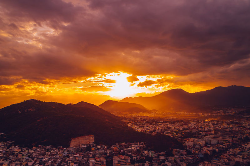 Nha Trang cityview on sunset Architecture Beauty In Nature Building Building Exterior Built Structure City Cityscape Cloud - Sky Environment Mountain Mountain Range Nature No People Orange Color Outdoors Residential District Scenics - Nature Sky Sunlight Sunset TOWNSCAPE