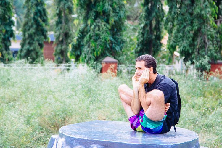 Portrait of man doing yoga