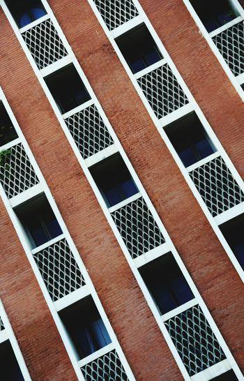Tilt Shot Of Brick Wall Windows