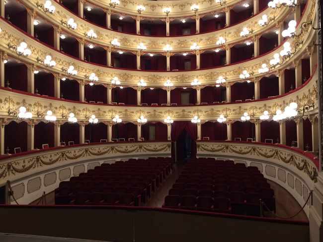 Architecture Arts Culture And Entertainment Auditorium Balcony Baroque Style Built Structure Comfortable Elégance Gold Colored Illuminated In A Row Indoors  Lighting Equipment Musical Theater  Nightlife No People Red Seat Stage - Performance Space Stage Theater Theatrical Performance