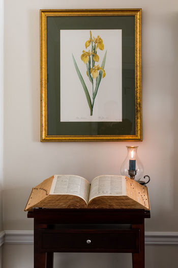 An old dictionary awaiting a new reader Research Candle Lit Dictionary Dictionary Stand Floer Rpint Peaceful Scene Spelling Study