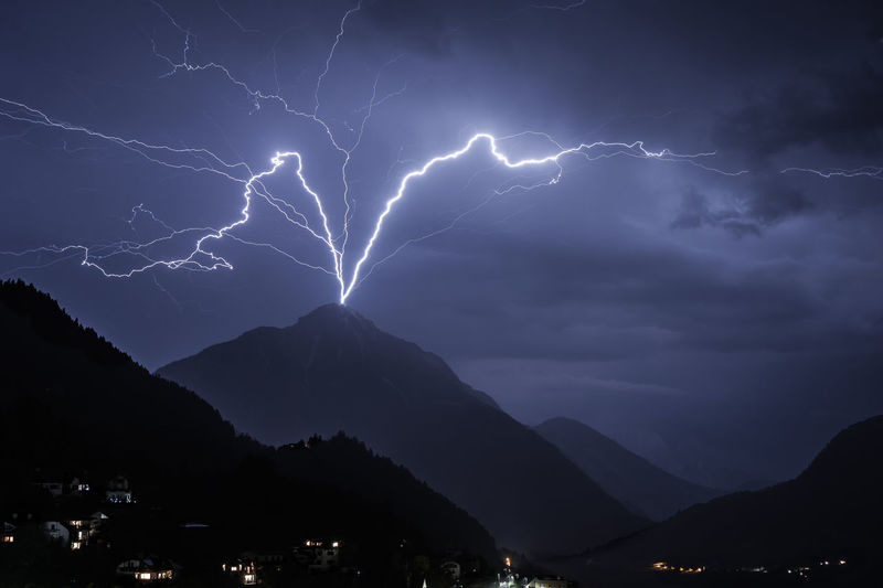 thunderstorm Thunderstorm Beauty In Nature Cloud - Sky Electricity  Forked Lightning Illuminated Light Lightning Mountain Mountain Range Nature Night No People Ominous Outdoors Power Power In Nature Scenics - Nature Sign Sky Storm Storm Cloud Thunderstorm Warning Sign