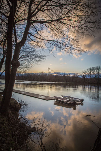 Schenectady, NY Bare Tree Beauty In Nature Boat Boats Branch Cloud - Sky Lake Mode Of Transportation Mohawk River Nature No People Outdoors Plant Reflection River Scenics - Nature Sky Sunset Sunset #sun #clouds #skylovers #sky #nature #beautifulinnature #naturalbeauty #photography #landscape Tranquil Scene Tranquility Transportation Tree Water Waterfront