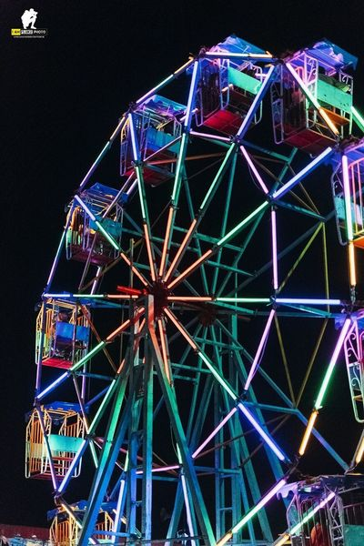 Amusement Park Ferris Wheel Amusement Park Ride Arts Culture And Entertainment Night Illuminated Built Structure Multi Colored Architecture Low Angle View No People Sky Lighting Equipment Outdoors Metal Fairground Geometric Shape Carnival Nature Glowing