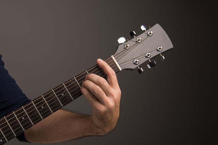 hand of a guitarplayer playing b-dur Acoustic Acoustic Guitar Arts Culture And Entertainment Chord Fretboard Guitar Human Hand Indoors  Men Music Musical Instrument Musical Instrument String Musician One Person People Playing Plucking An Instrument Studio Shot