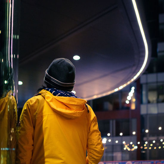 Night Rear View Real People Illuminated Men Focus On Foreground One Person Architecture Lifestyles Waist Up Built Structure Clothing Standing Building Exterior City Leisure Activity Outdoors Light - Natural Phenomenon Casual Clothing Hairstyle Curves And Lines Curve