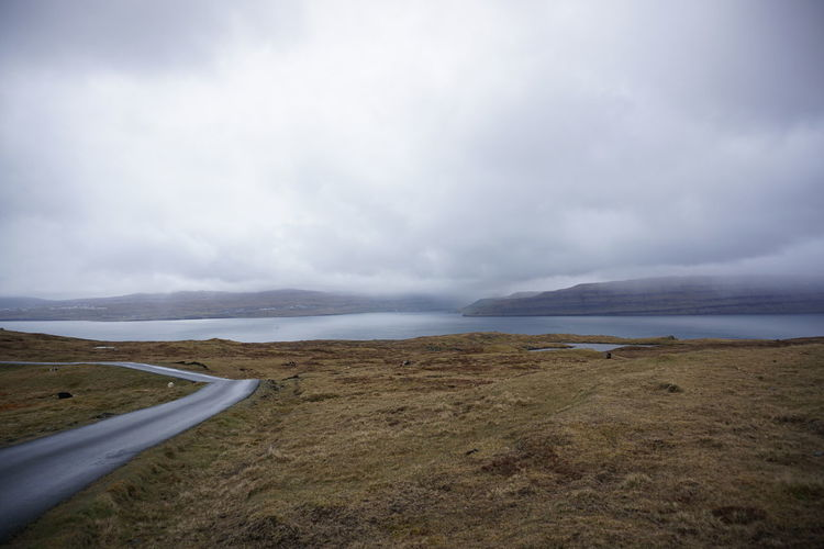 Calm Cloud - Sky Cloudy Coastline Faroe Islands Landscape No People Outdoors Remote Road Scenics Sky Tranquil Scene Tranquility Water Æðuvík