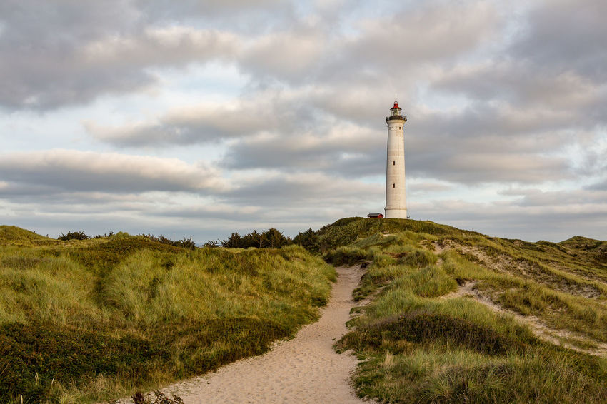 Denmark, Sondervig Denmark Ringkøbing Fjord Søndervig Architecture Beauty In Nature Cloud - Sky Day Direction Grass Green Color Landscape Lighthouse Low Angle View Nature No People Non-urban Scene Outdoors Physical Geography Ringkøbing Sand Dune Scenics Sky Tranquility Water