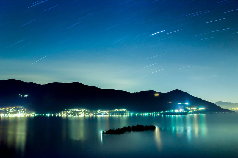 Alpine Lake Maggiore with Brissago Islands and Mountain at Night wit Star Trails in Ticino, Switzerland. Alpine Lake Beauty In Nature Brissago Islands Illuminated Island Lake Lake Maggiore Landscape Long Exposure Mountain Mountain Range Nature Night No People Outdoors Reflection Scenics Sea Sky Star - Space Star Trail Swiss Alps Tranquil Scene Tranquility Water