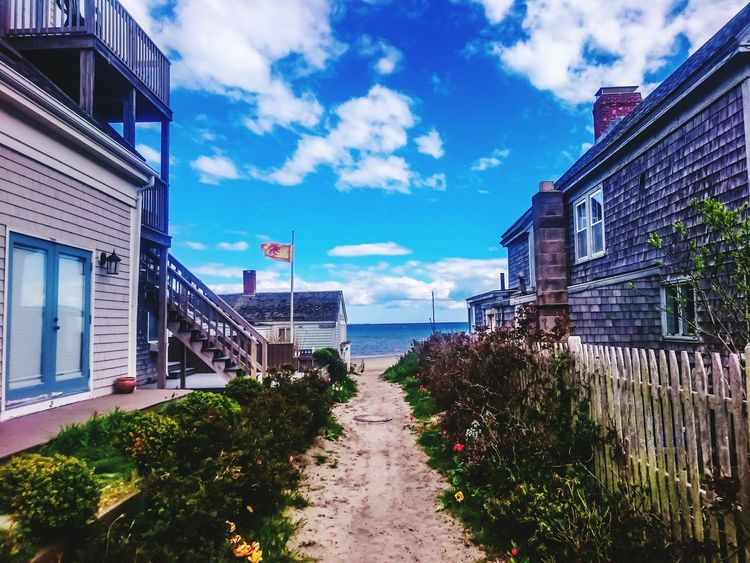 Summer is starting Houses New England  Atlantic Ocean Path Sand Grass Flowers Beach Beachphotography Cloud - Sky Sky Water Architecture Outdoors No People Travel Destinations Flag Sand And Sea Cloud_collection  Cloud And Sky