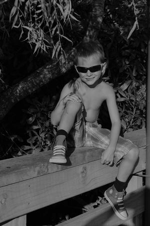 Blackandwhite Boy Childhood Close-up Cool Kids Day Eyeemnaturelover EyeEmNewHere Fresh On Eyeem  Full Length Happiness Leisure Activity Lifestyles Looking At Camera One Person Outdoors Portrait Real People Sitting Smiling Sunnies Young Adult The Portraitist - 2017 EyeEm Awards