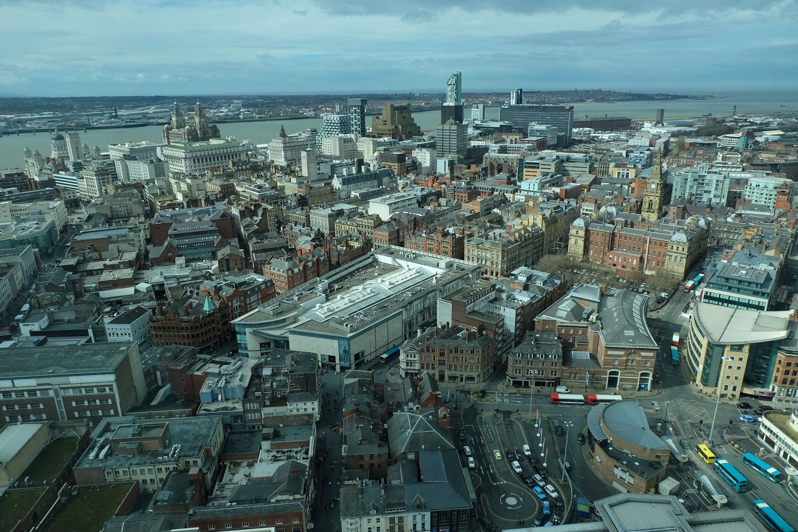 building exterior, architecture, built structure, city, high angle view, cityscape, crowded, sea, sky, city life, residential district, water, residential building, residential structure, street, transportation, incidental people, large group of people, elevated view, outdoors