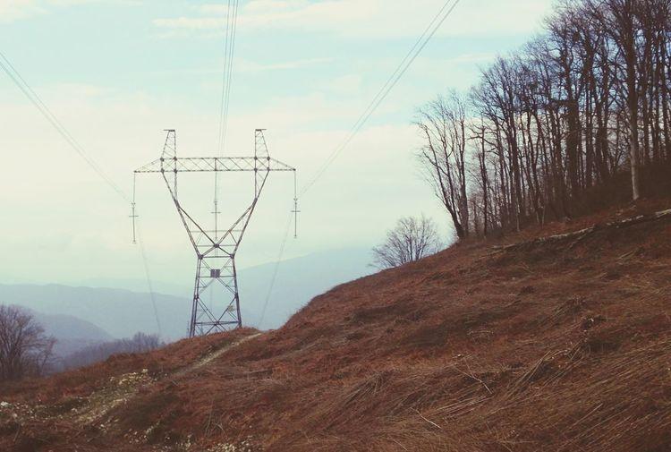 Electricity Pylon On Hillside