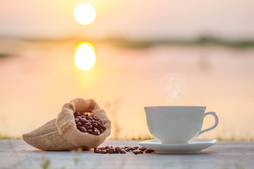 coffee cup and coffee bean in the morning Sunlight Bean Close-up Coffee - Drink Coffee Cup Day Drink Food Food And Drink Freshness Healthy Eating Nature No People Refreshment Sackcloth Sunrisre Sunset