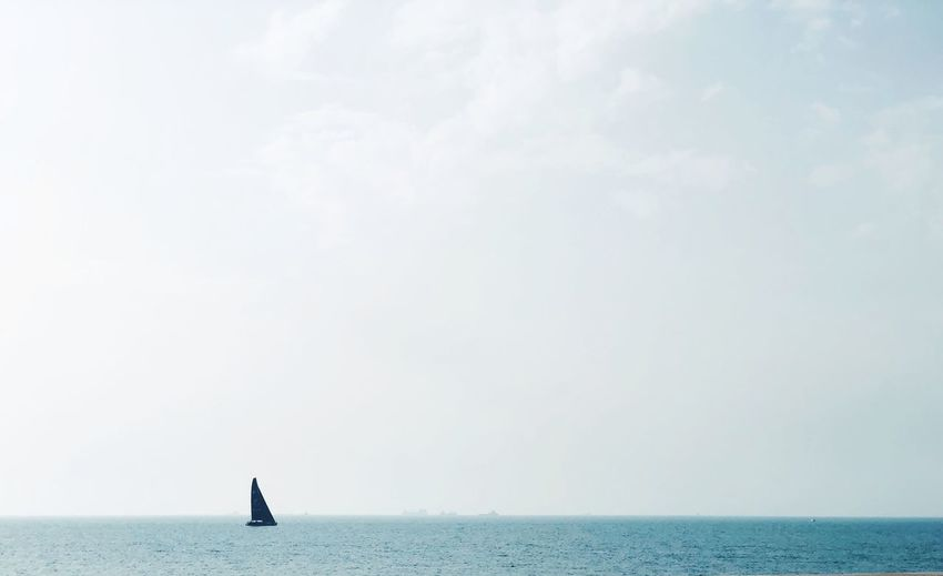Sail in open blue sea Sailing Boat Sailing Ship Sailing Sailboat EyeEm Selects Sea Water Sky Horizon Horizon Over Water Beauty In Nature Waterfront Scenics - Nature Day Nautical Vessel Cloud - Sky Outdoors Mode Of Transportation Copy Space Tranquility Nature Tranquil Scene The Traveler - 2019 EyeEm Awards