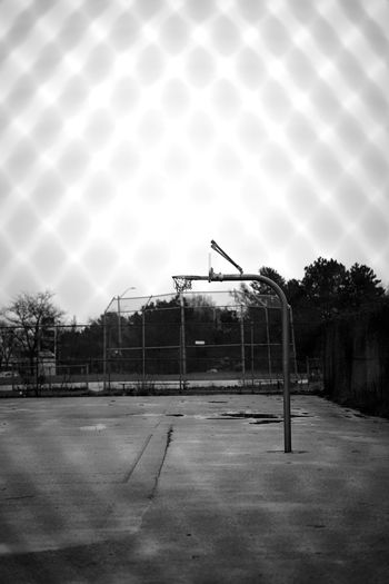 empty court Basketball Day Deserted Emply Plates Fence Monochorme Monochrome No People Old Outdoors Sky Tree Vacances