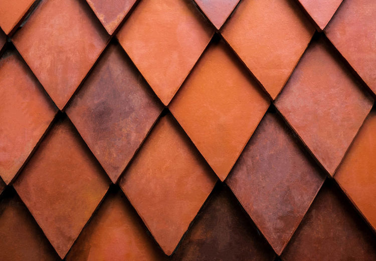 Close up texture of orange rhombus brick. Wall for exterior or interior design. Building material. Background concept. Full Frame Backgrounds Pattern Close-up No People Indoors  Design Diamond Shaped Arts Culture And Entertainment Shape Leather Copy Space Creativity Textured  Directly Above Triangle Shape Repetition Paper Empty Brown Stage