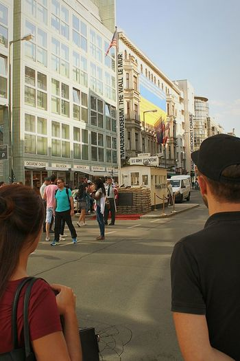 Watch out! Checkpoint Charlie. Checkpoint Charlie Checkpointcharlie Berlin Germany Army US Flag USA FLAG Flag Military Police Police Officer Street Photography Streetphotography Exeptional Photographs Finding New Frontiers City Adults Only People Architecture Sky Outdoors Cityscape Mauermuseum Rear View